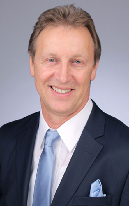 DR. PETER HOLZSCHUH